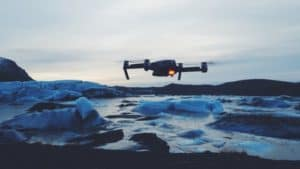 Drone flying over a body of water