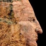 Rock art of a mans face facing right