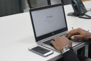 person typing on a laptop in google chrome