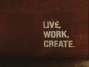 live, work, create painted on a brick wall