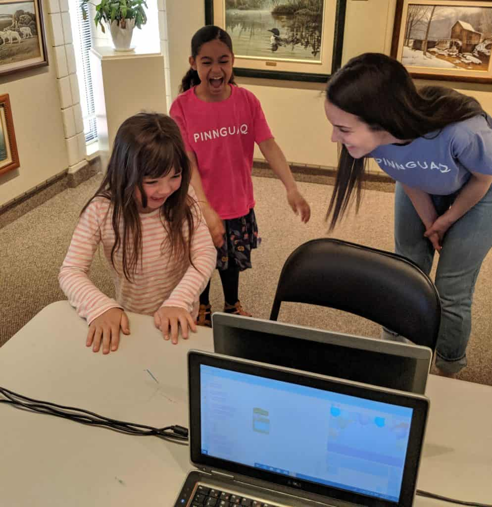 emily teaching two female students
