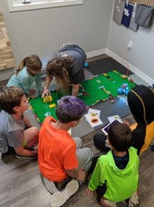 becky teaching kids in a circle