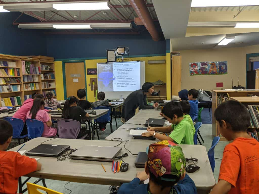 students in a classroom learning about character design