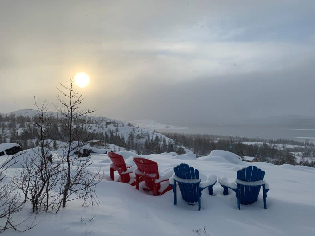 red and blue chairs overlooking breath taking landscape