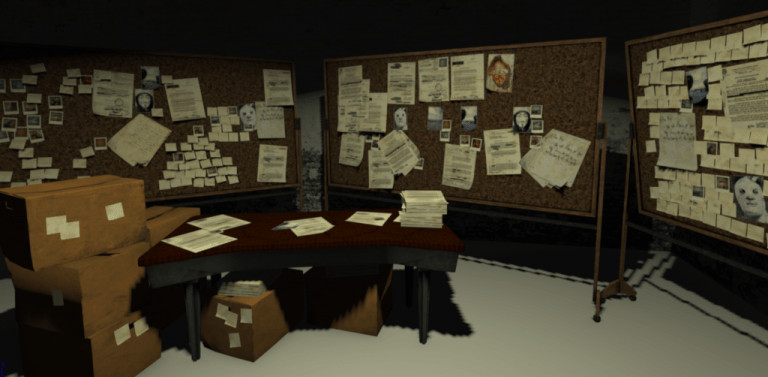 An office room with different bulletin boards and a desk with boxes