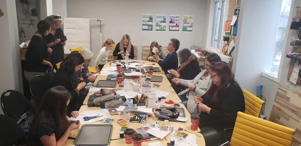 group of woman in a beading workshop at the lindsay makerspace