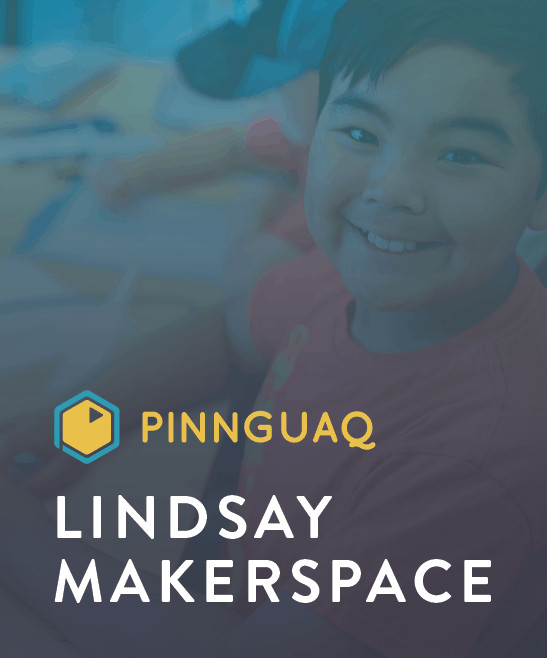 a kid smiling at the camera with pinnguaq lindsay makerspace written on the bottom left corner of the picture