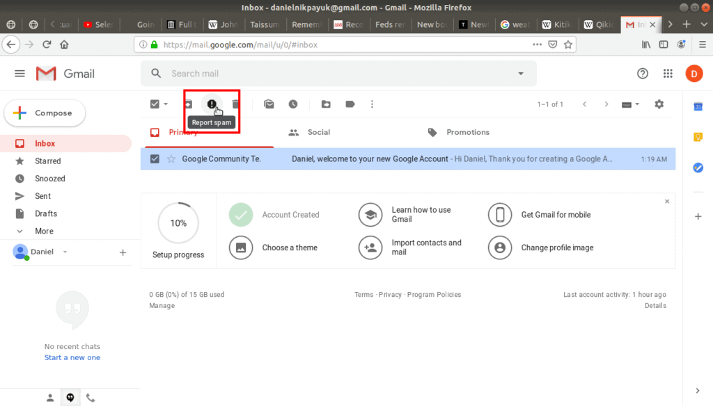 Report spam highlighted in gmail's tool bar.