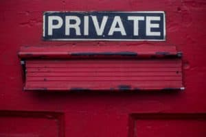 private sign on a red building