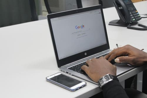 man on his computer typing something into google chrome. Web use and safety series.