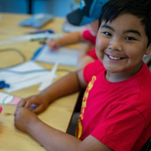 A student smiling at a camp at the Iqaluit Makerspace.