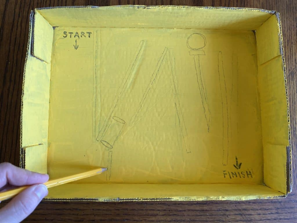 person sketching into a yellow box