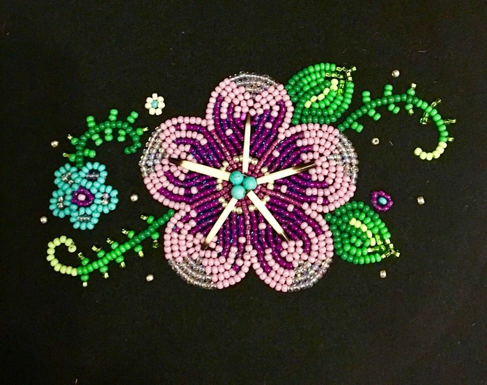 A purple quillwork and beadwork flower by 4 Sisters Métis Beadwork.