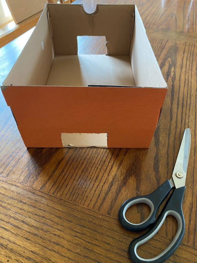 A box with two squares cut out from each end.