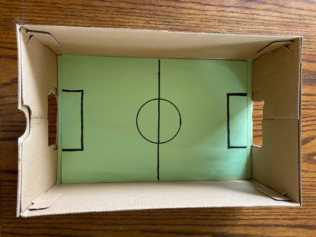 a foosball table in a box