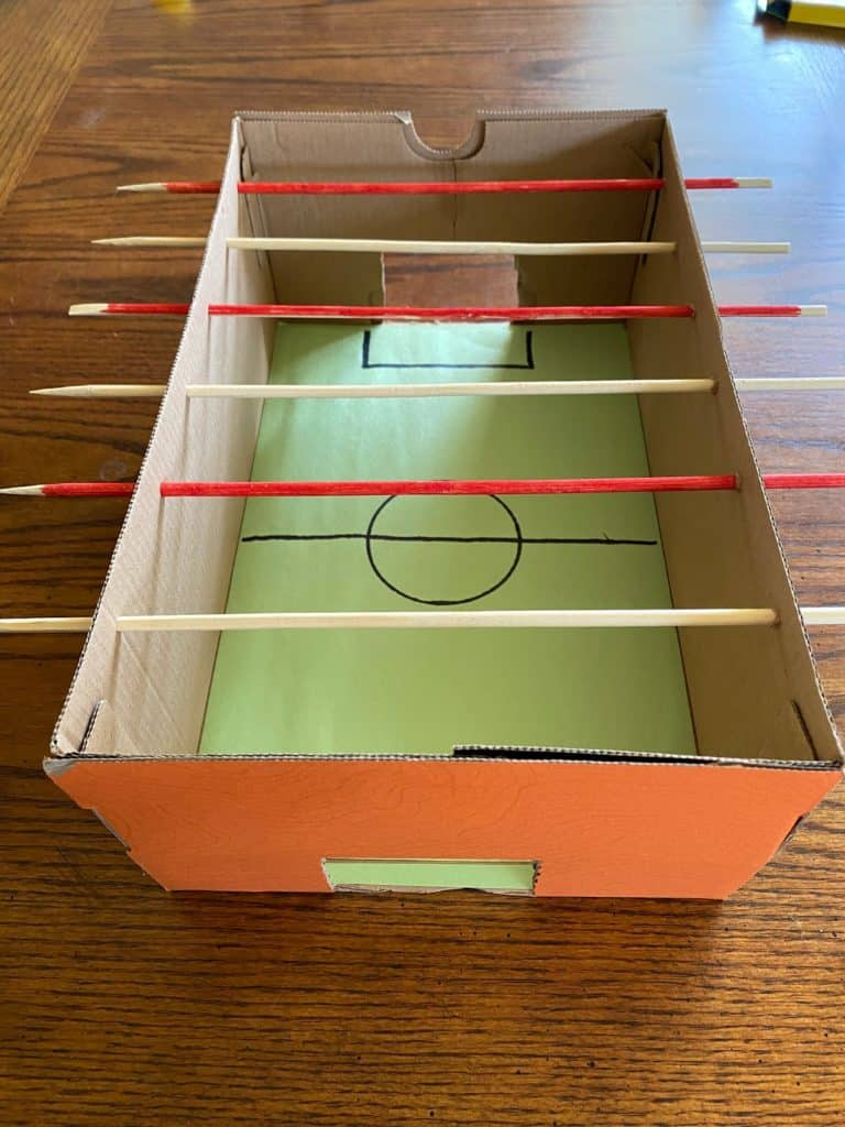 The foosball box with rods added.