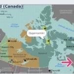 "Critter on a map of Nunavut saying ""Qujannamiik!"""