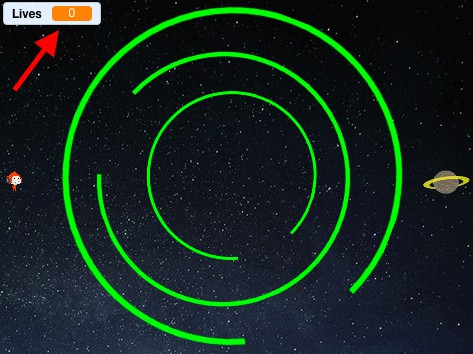 """Screen capture of a game in Scratch. A red arrow points towards the """"Lives"""" counter in the top left corner."""