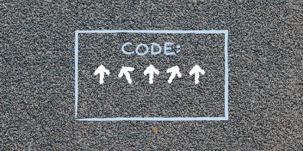 A code box with arrows inside drawn on pavement,