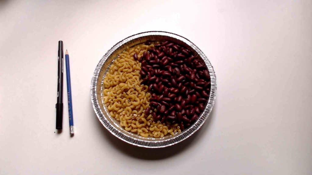 Pasta and beans in a bowl.