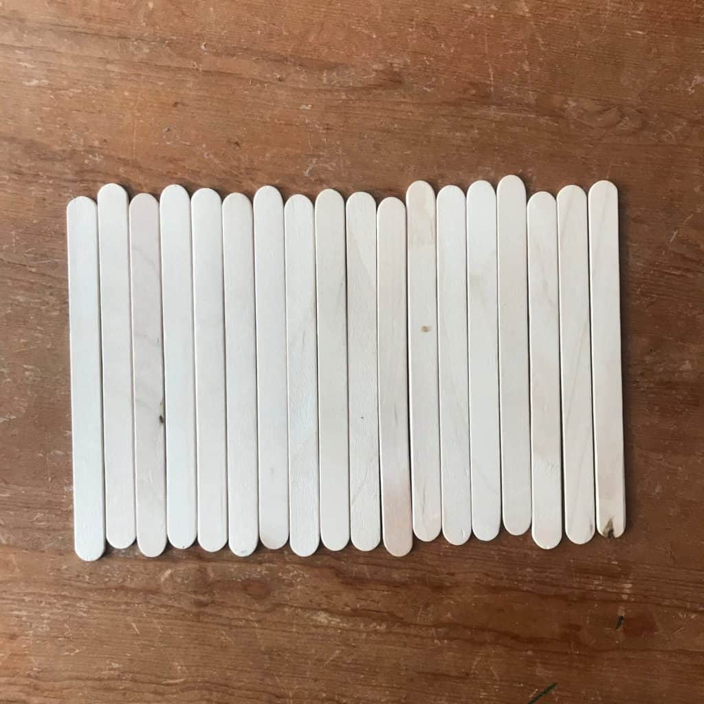 Popsicle sticks laying side by side.