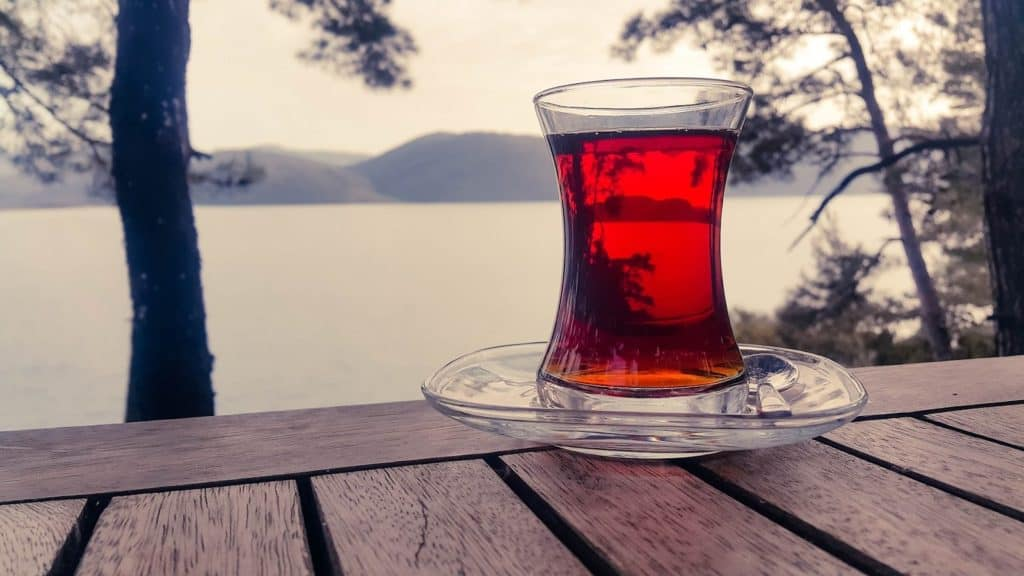 Tea sitting on a wooden table, looking out over the lake.