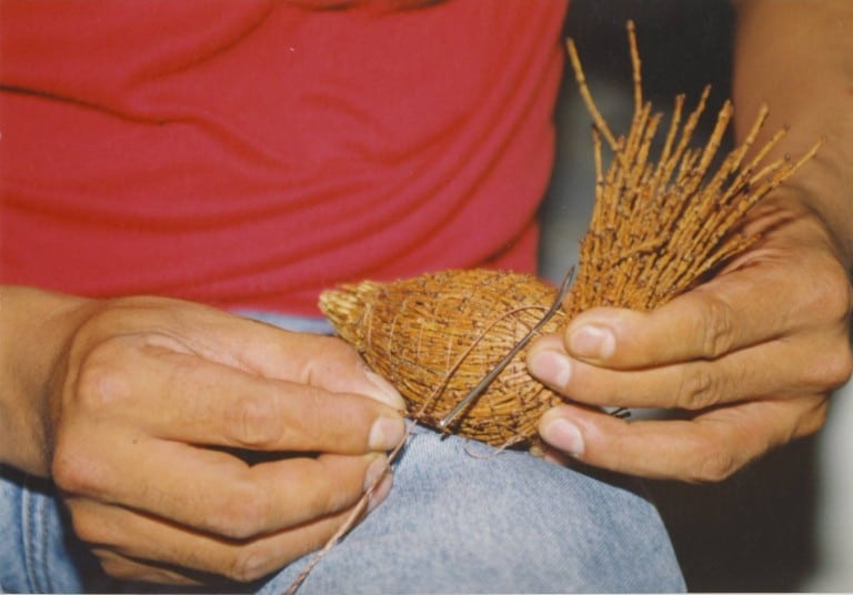 A man working with roots.