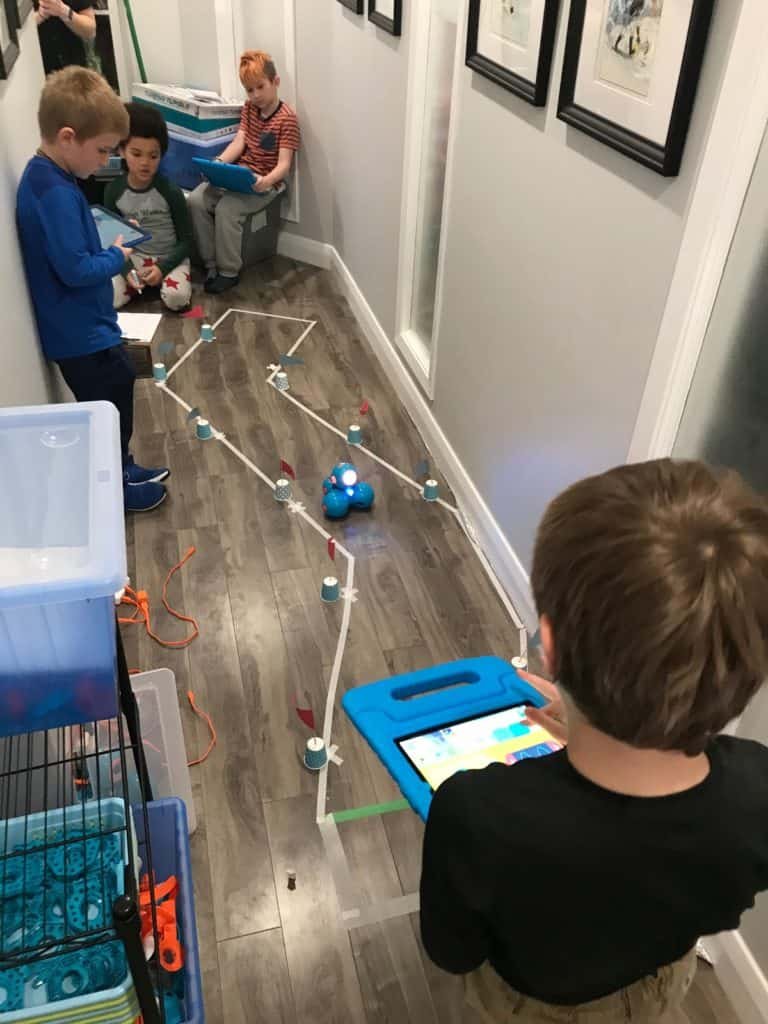Students in the Lindsay Makerspace using Dash and Dot robots in a group made obstacle course.