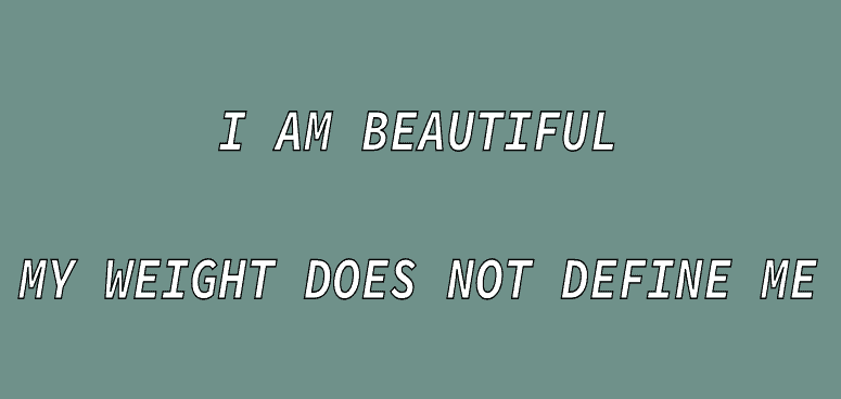 """The phrase """"I am beautiful my weight does not define me"""" written in white writing."""