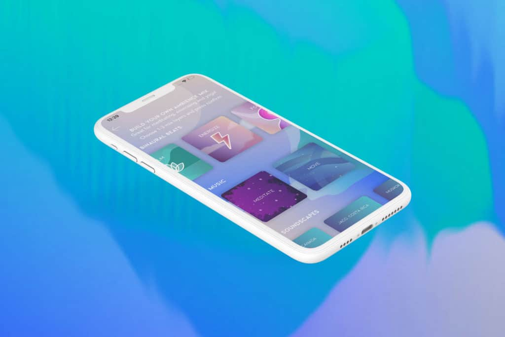 A phone laying on an abstract background of greens, blues and purples.