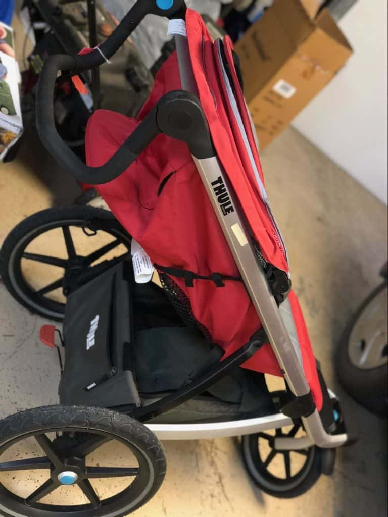 A red THULE stroller.