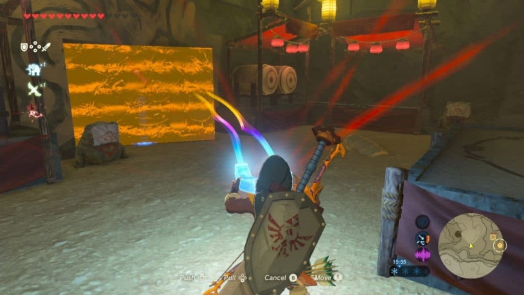 A player using the magnet tool to open a wall behind a treasure in the Yiga Clan hideout in the Zelda Breath of the Wild game