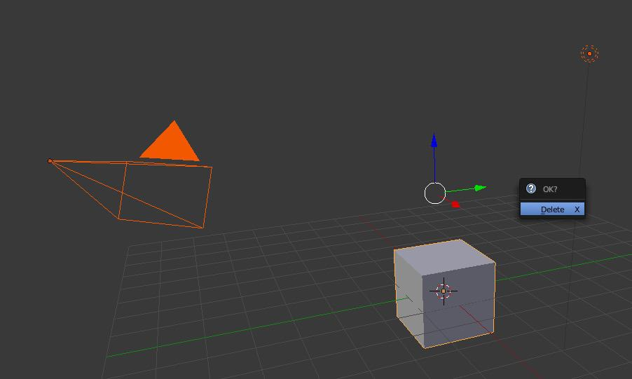 Deleting a cube in the Blender interface.