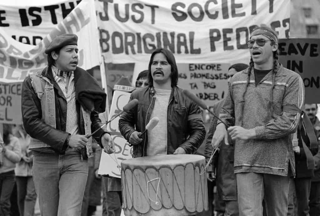 3 indigenous men drumming at the march on Parliament Hill on November 16, 1981.