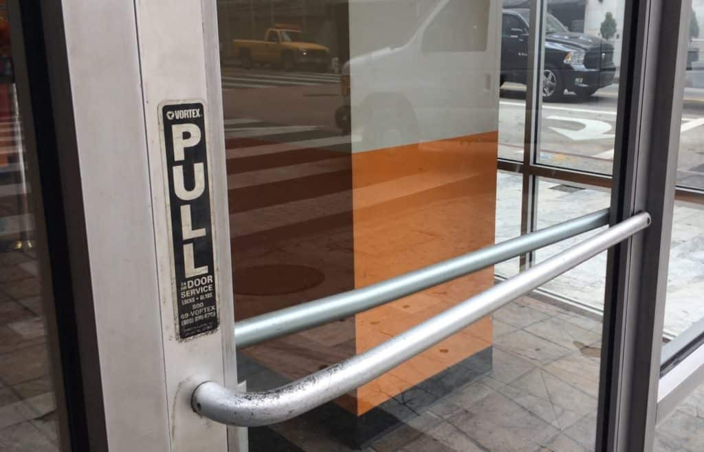 A glass door that has a sign