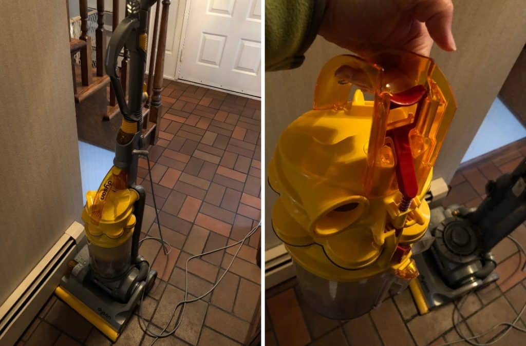 A dyson vacuum with yellow interactive components