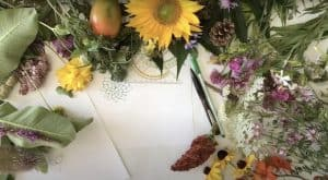 Flowers laid out on a white piece of paper.